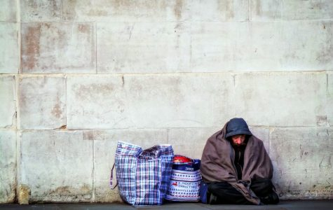 Homeless man found resting in the streets.