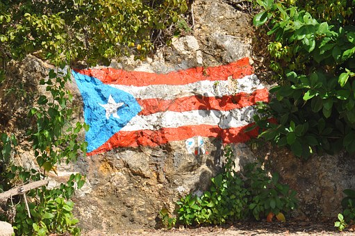Puerto Rico's flag painted on a rock.