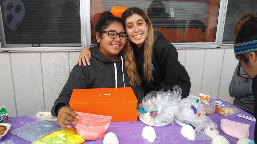 Daniella Ledezma and Melisa Luis, members of Make a Difference Club, helped students make sugar skulls for Day of the Dead.