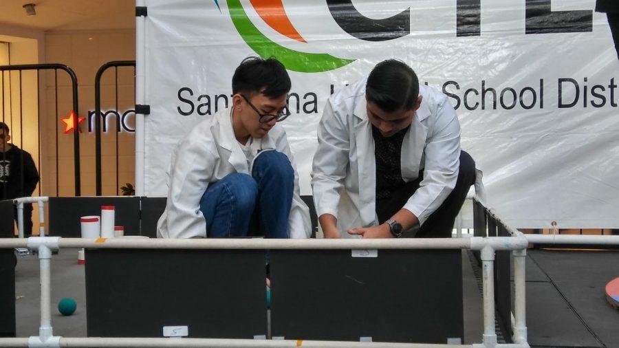 Quan Do and Juan Medina from the Robotics team at the School Choice Fair.