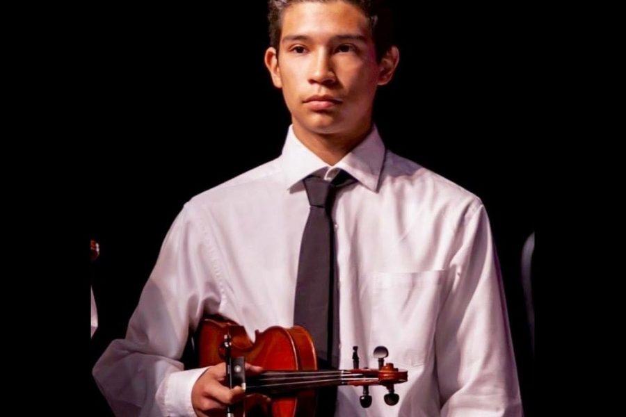 Justin Salgado performing at a recital.
