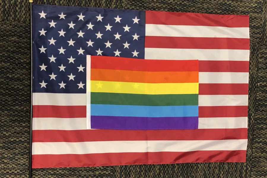 LGBTQ+flag+on+top+of+the+American+flag.