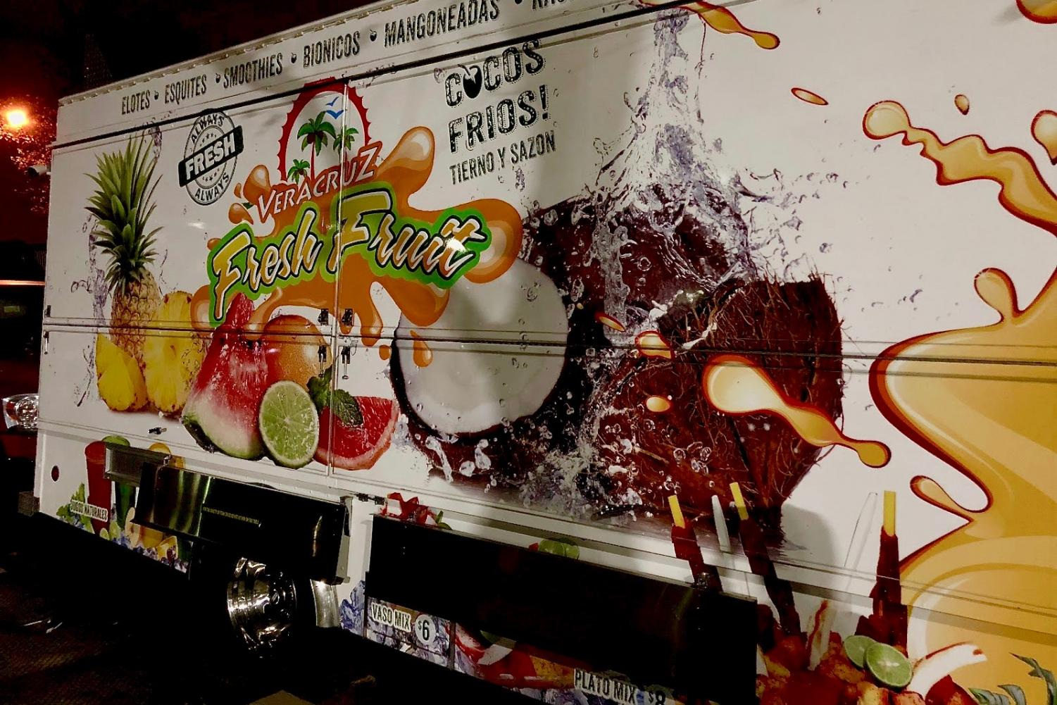"The ""Veracruz Fresh Fruit"" truck closes for the day."