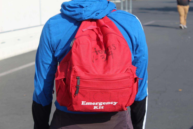 Senior Alan Meza wears an emergency backpack.