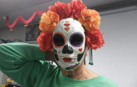Mrs. Groff wears a Mexican Dia de los Muertos mask to teach her students about the   holiday.