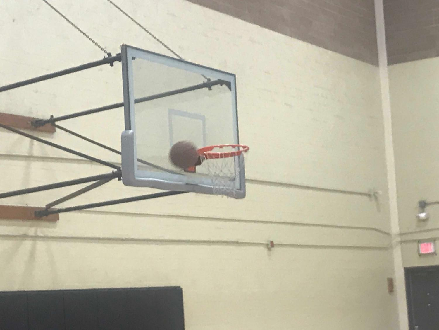 Basketball hoop located in the small gym.