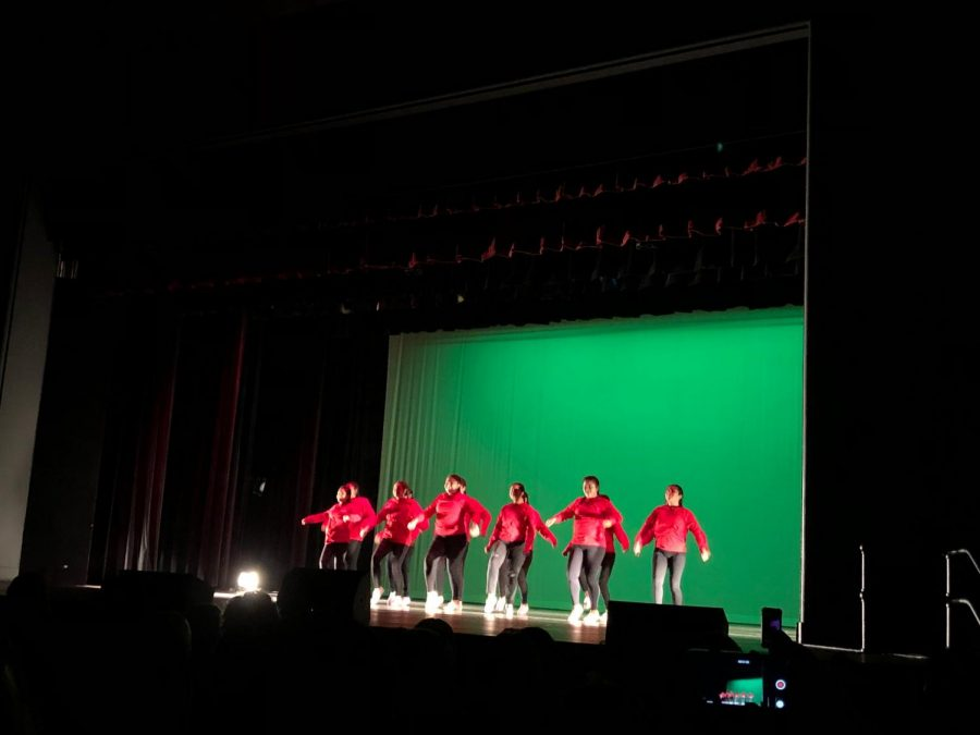 The  whole team performs together on stage.