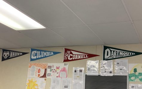 Photograph of college pendants on a classroom wall at Middle College High School.