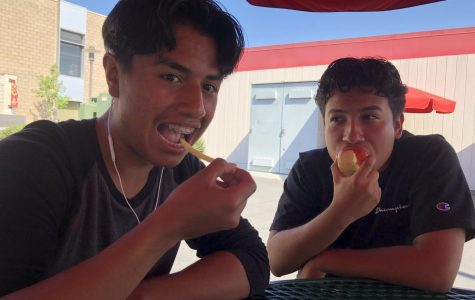 Senior Andres Reyes consumes McDonald's fries while Senior Alan Cuevas eats an apple to maintain his healthy habits