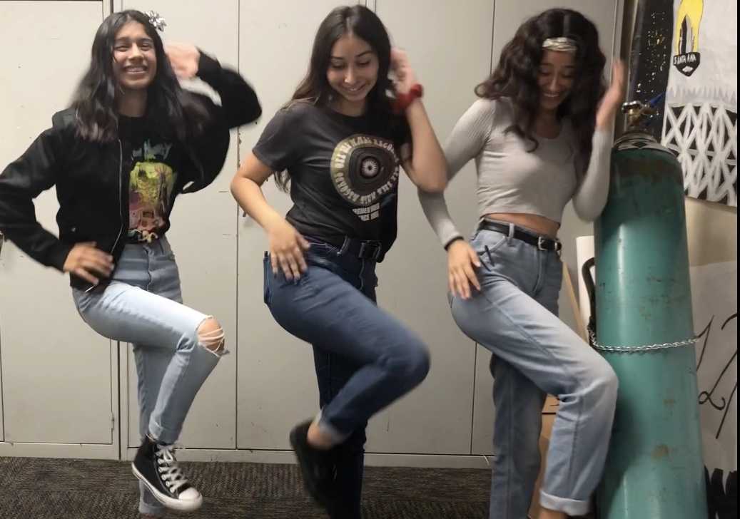 Sandy+Villalobos+%28left%29%2C+Jackie+Robleos+%28center%29%2C+and+Cristina+Alvizo+%28Right%29+are+seen+laughing+and+having+fun+dancing+to+their+favorite+TikTok.+Photo+Credit+Sahira+Cari%C3%B1o