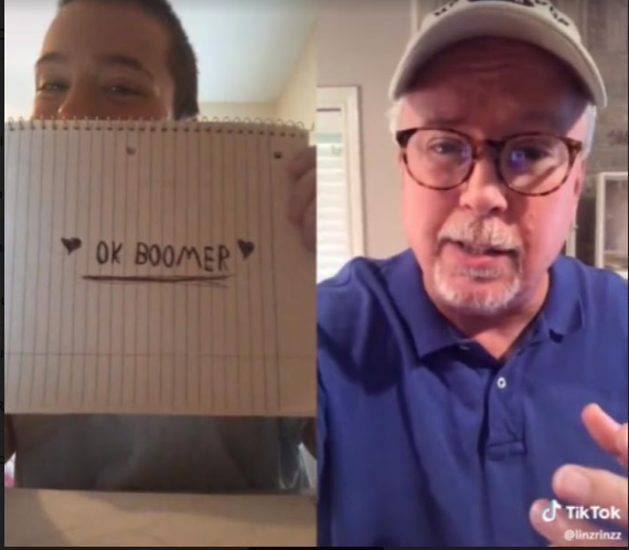 TikTok user lin@linzrinzz holds up a piece of notebook paper that reads 'OK BOOMER' while an older man wearing a baseball cap insults millennials and the Generation Z.