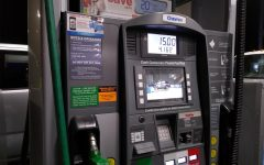 A customer buys $15 dollars worth of gasoline at Chevron to travel back home on March 6, 2020.