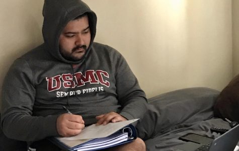 College student Francisco Guerrero, who is also this reporter's brother, completes his schoolwork from home due to the switch to online classes.