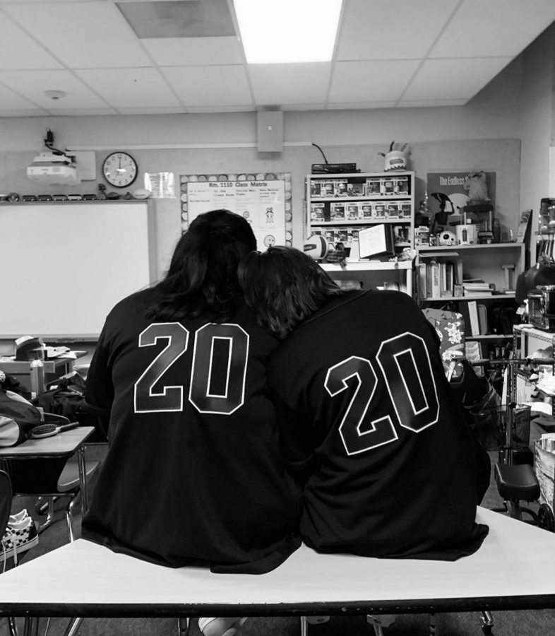 Dance Team presidents, Daniela Flores and Genesis Serratos, lovingly lean on each other at school right before a performance.