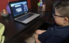 A second grade elementary student attends an online Zoom class.