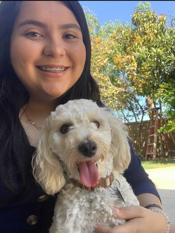Senior Karina Romero spends time with her puppy to relieve stress and have fun.