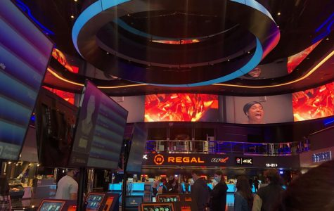 Regal Irvine Spectrum movie theater's renovation features immersive digital movie posters as well as self serving ticket booths.