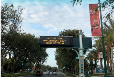 Traffic sign directs people towards the Disneyland Resort vaccination site in the Toy Story parking lot.