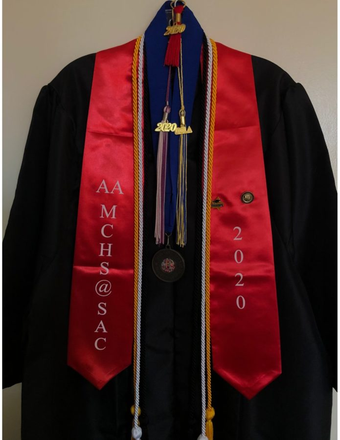 MCHS+Alumni+Daniela+Flores+is+a+first-gen+and+low-income+student+who+graduated+with+numerous+accomplishments%2C+which+are+displayed+through+tassels%2C+graduation+cords%2C+and+more.
