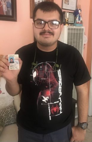 Senior Joseangel Regalado, shows off his license after passing the test.