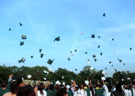 Graduates throw their caps in the air as they celebrate. (Creative Commons)