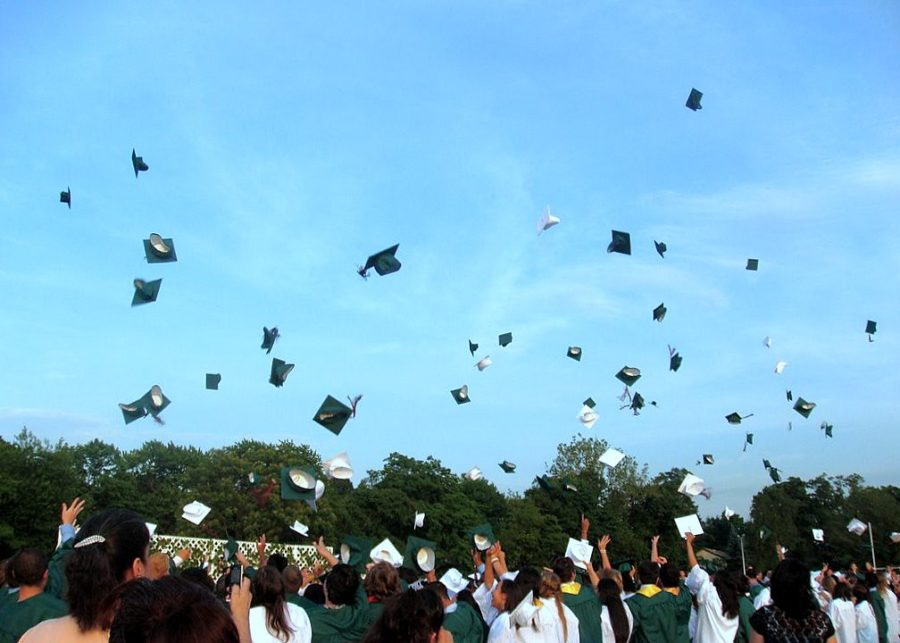 Graduates+throw+their+caps+in+the+air+as+they+celebrate.+%28Creative+Commons%29